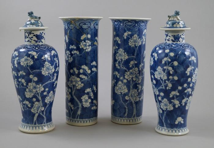 A Pair Of Chinese Blue And White Baluster Vases The Lids With Lion