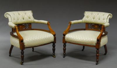 A Pair Of Edwardian Mahogany And Inlaid Upholstered Tub Chairs With Fret  Carved Back Panel On Turned Front Legs To Brass Caps And Casters (2)